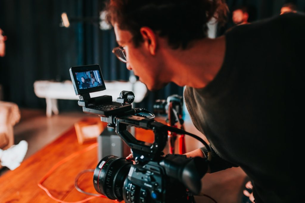 man recording a video
